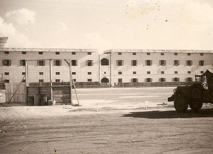 The Canning Road Barracks in New Delhi, India, where the enlisted men of the 835th Signal Service Battalion were quartered. The softball field is shown in the foreground.