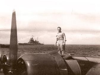 Lt. George Grimm on the wing of his PB2Y in Tokyo Bay.