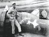 Howard R. Oglesby with his P-47 fighter.