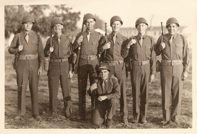 Picture of the signals team taken at Camp Crowder, Missouri, in 1944 before shipping out to India. Standing left to right: Edward Dalton, Marshall Windmiller (age 20), Joseph Ecaltz, Virgil Danielson, Irwin Miner, Guiseppe Macaluso. Kneeling: William Rodemann (Lt.)