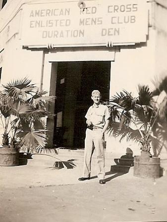 Marshall Windmiller standing outside of the American Red Cross Enlisted Men's Club Duration Den in New Delhi.